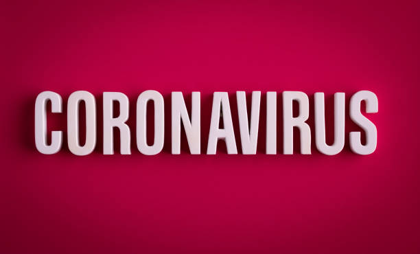 COVID-19 coronavirus sign lettering on a colored background stock photo