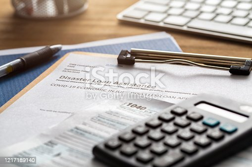 SBA - Small business administration economic injury disaster loan and emergency advance submitted application and tax forms from small business owner applying for relief due to the coronavirus / covid-19 pandemic