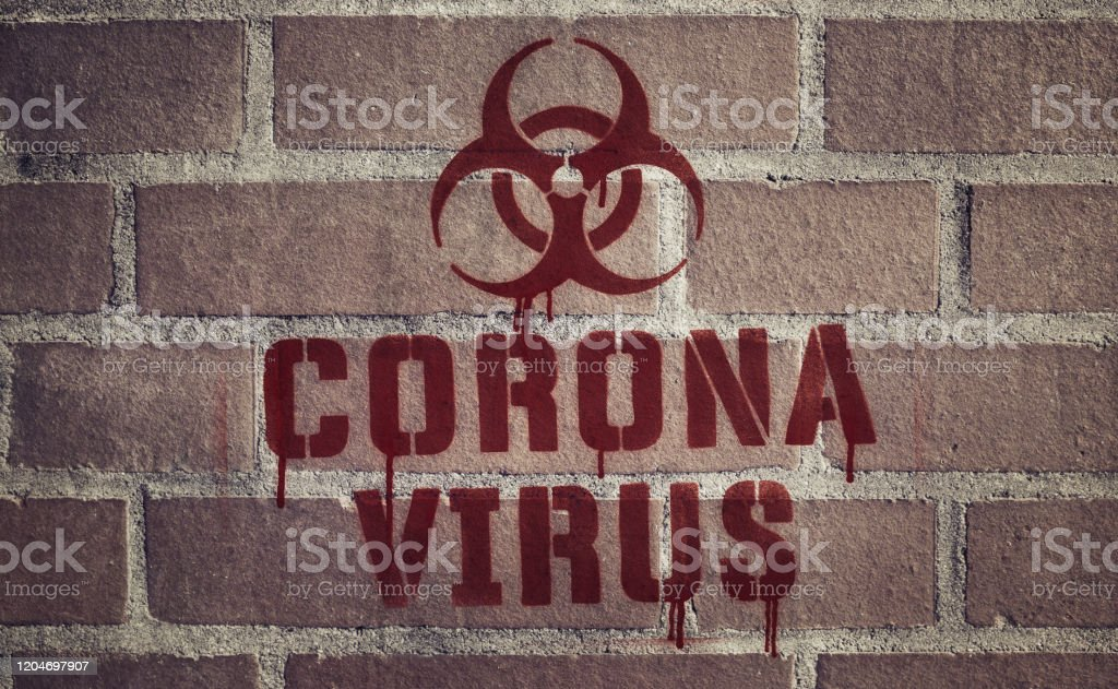"""""""Coronavirus"""" Stencil Spray-Painted on Brick Wall - Royalty-free Accidents and Disasters Stock Photo"""