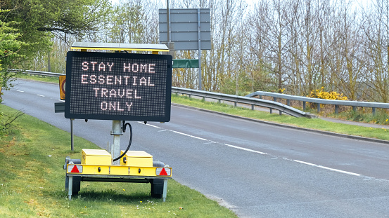 Road sign indicating essential travel only due to the Covid-19 lockdown