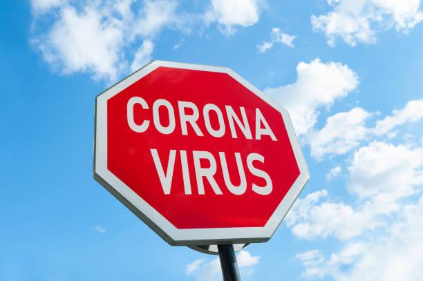 Coronavirus warning on stop sign stock photo