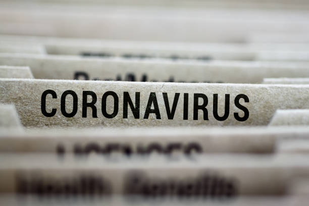 coronavirus written on file folder label - polmonite virus foto e immagini stock