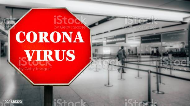 Coronavirus written on stop sign with passengers arriving at passport picture id1202135320?b=1&k=6&m=1202135320&s=612x612&h=jpi0nv1ooxj 5bhptgiwwrbou6wlef3iggoyzp6wyu0=