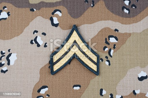 istock US ARMY Corporal rank patch on desert camouflage uniform background 1206926340