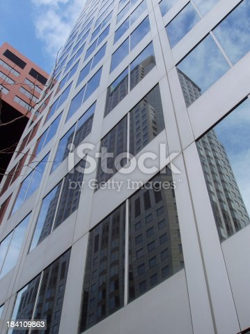 Exterior perspective of office buildings and sky in downtown St. Louis.