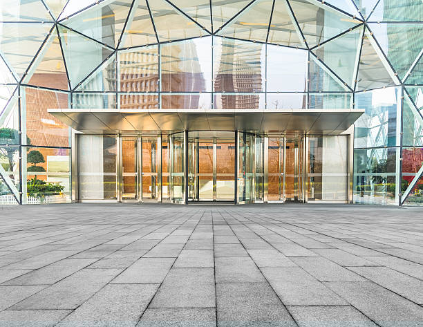 corporate building entrance - entrance stock photos and pictures