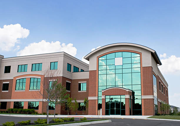 Corporate Building Red brick building with blue tinted glass windows. community center stock pictures, royalty-free photos & images