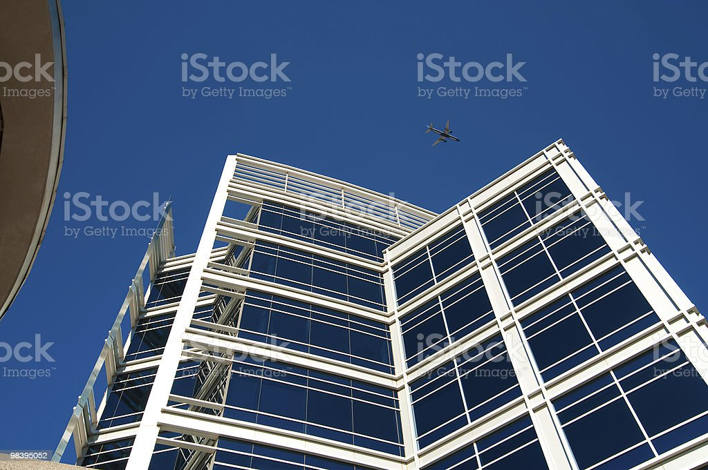 Corporate building with plane royalty-free stock photo