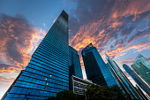 Corporate buildings against dramatic sunset sky