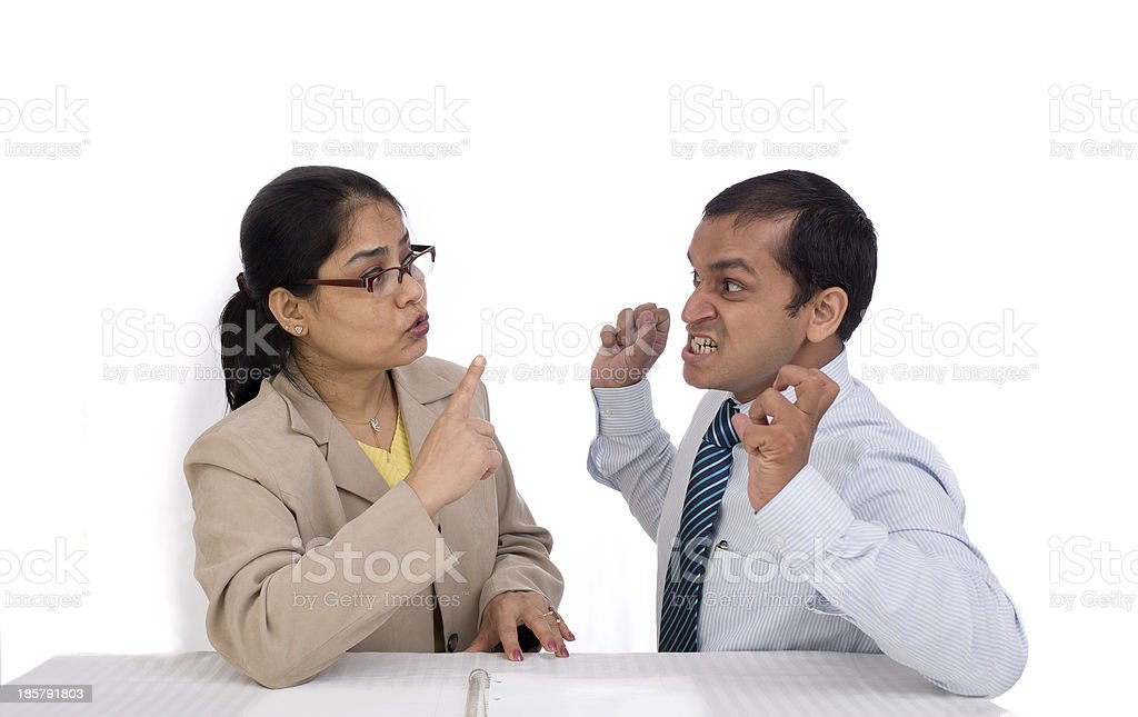 Corporate bully : Indian businessman and businesswoman fighting royalty-free stock photo