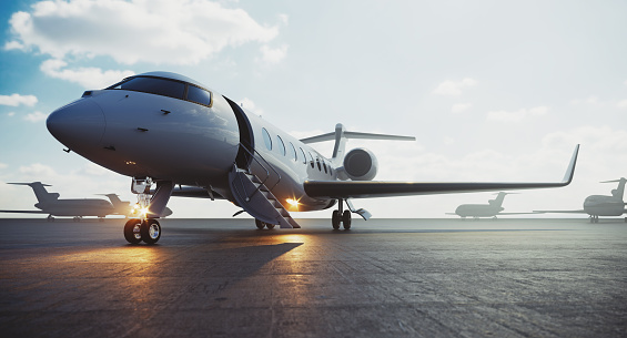 Corporate business class jet airplane parked at airfield and waiting vip persons for take off. Luxury tourism and business travel transportation concept. 3d rendering
