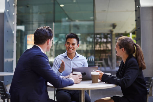 Corporate business meeting outdoors on the move. stock photo