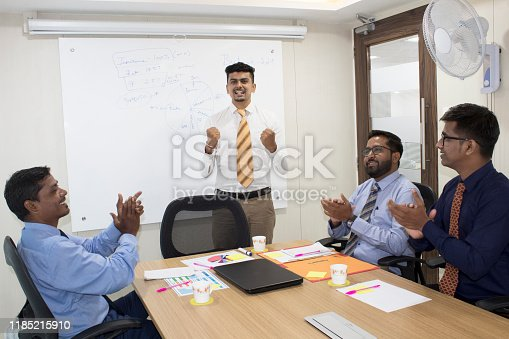 938516440 istock photo Corporate business team celebrating success 1185215910