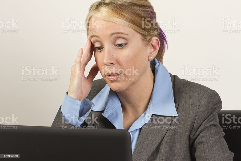 Corporate business woman discouraged and frustrated in front of computer stock photo