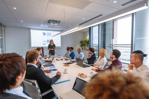 Corporate Executive Team Listening to CEO Presentation stock photo