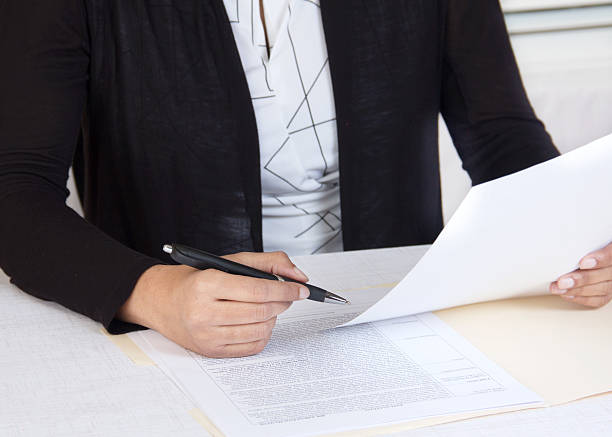 Corporate executive working in her office stock photo