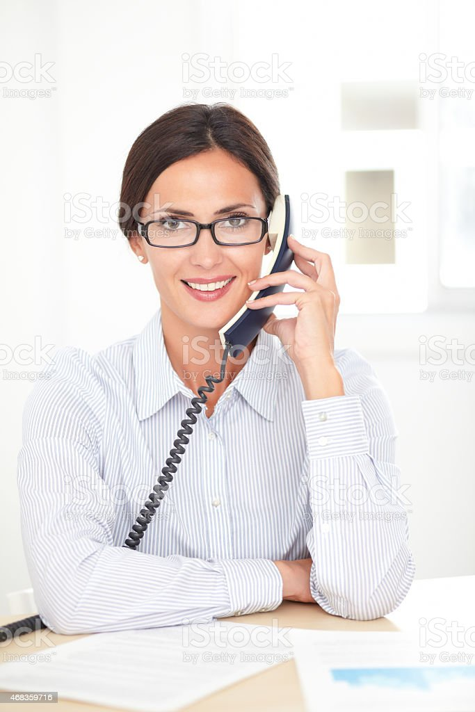 Corporate female employee talking on the phone royalty-free stock photo