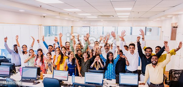 Corporate Business, Indian, Office - Large Group of Cheerful Business Executives Looking at the Camera for a Group Portrait at their office