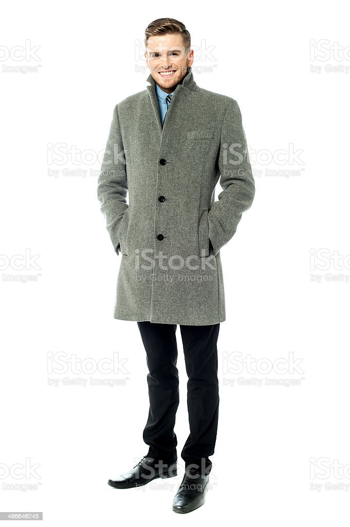 Corporate guy wearing long overcoat stock photo