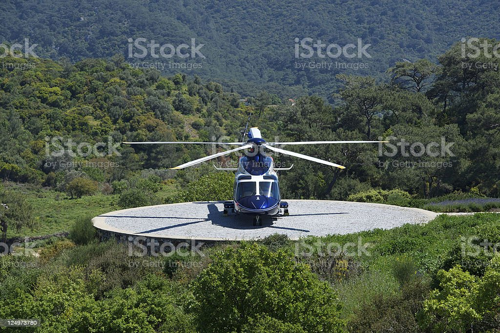 Corporate Helicopter Parked in Nature stock photo