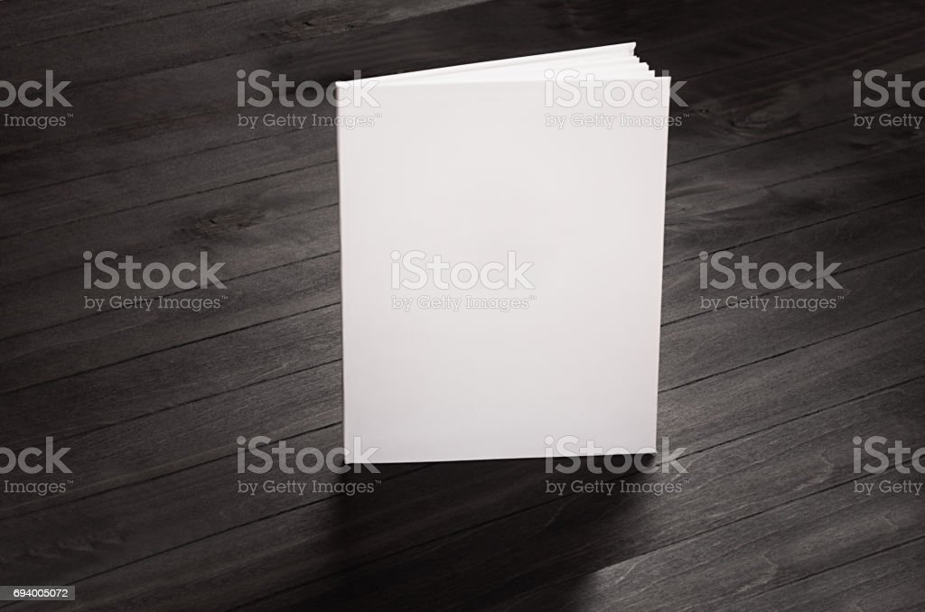 Corporate identity blank broshure standing on black stylish wood background, mock up. stock photo