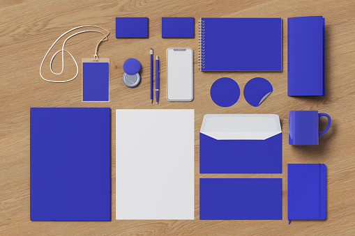 Corporate identity. Blue stationary branding set mock up on wooden background. 3d illustration