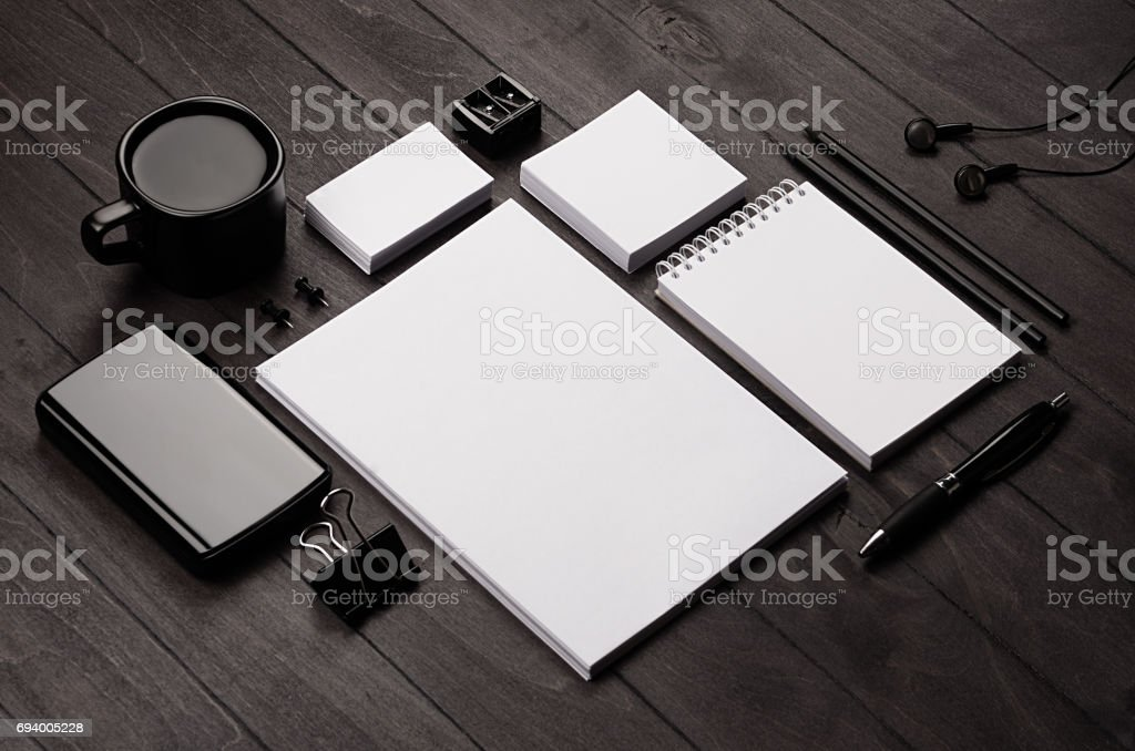 Corporate identity template,  blank stationery set with coffee and earphone on black stylish wood background. Mock up for branding, business presentations and portfolios. royalty-free stock photo