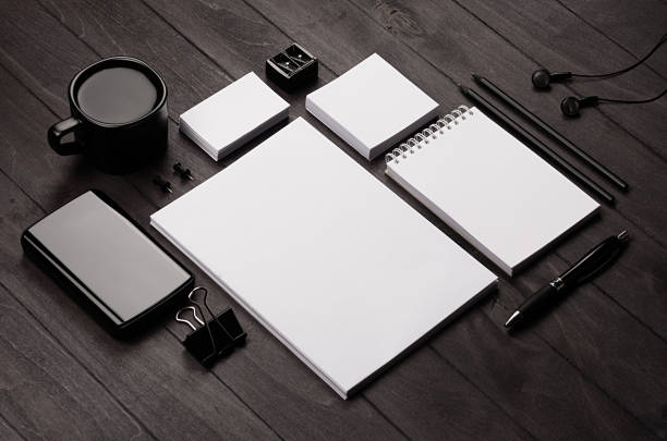 Corporate identity template,  blank stationery set with coffee and earphone on black stylish wood background. Mock up for branding, business presentations and portfolios. stock photo