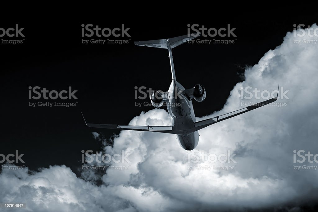 XL corporate jet airplane at night stock photo