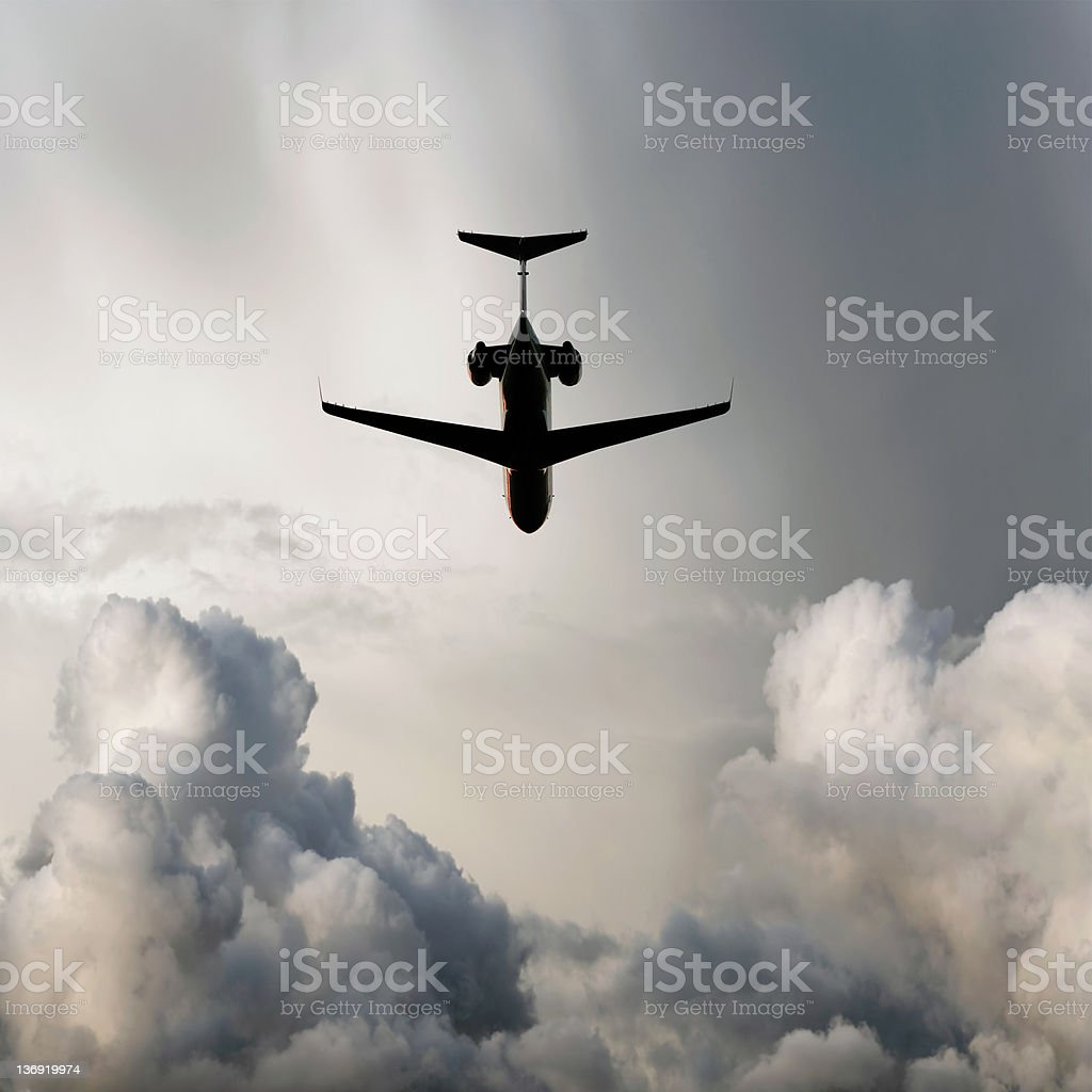 XXL corporate jet airplane flying in storm royalty-free stock photo