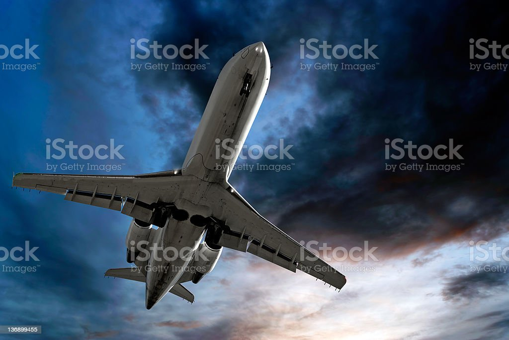 corporate jet airplane landing at dusk royalty-free stock photo