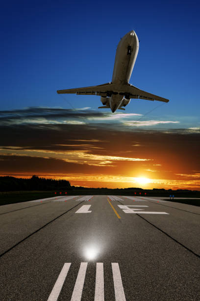 XL corporate jet airplane landing at sunset stock photo