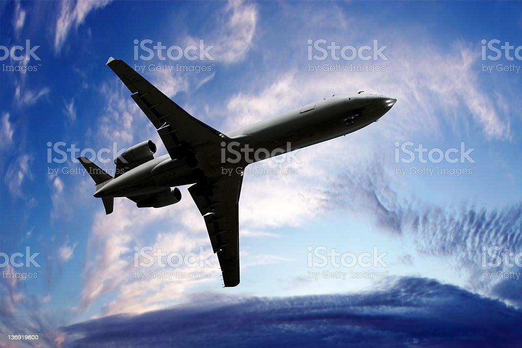 XL corporate jet airplane landing at twilight royalty-free stock photo