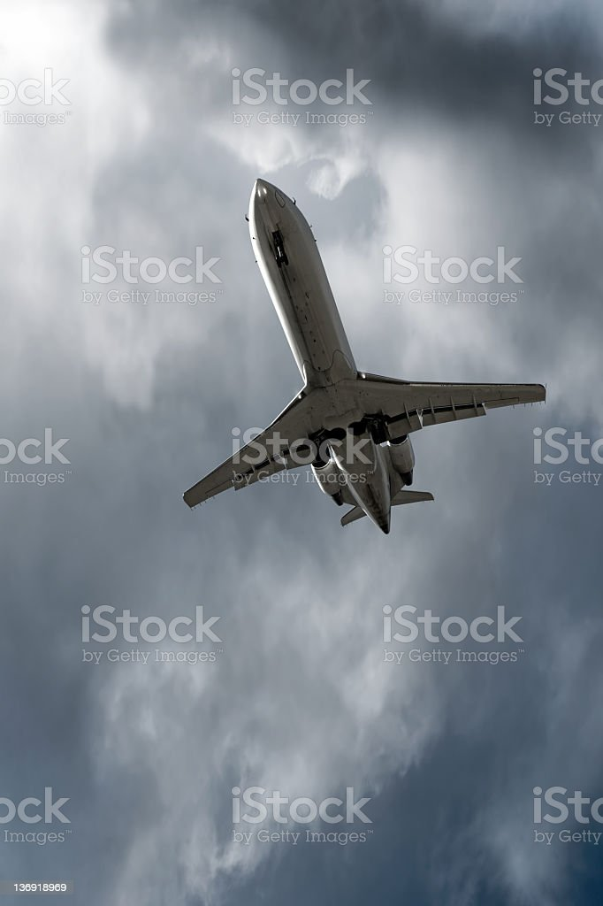 XXL corporate jet airplane landing in storm royalty-free stock photo