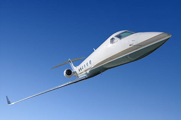 Corporate jet frontal view Gulfstreaam corporate jet isolated against blue sky supersonic airplane stock pictures, royalty-free photos & images