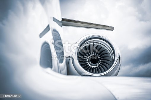 Detail of a corporate jet fuselage and engine.
