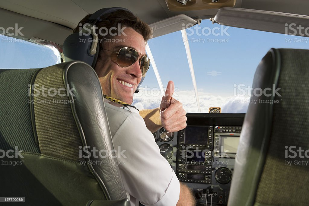 Corporate Jet pilot giving thumbs up royalty-free stock photo
