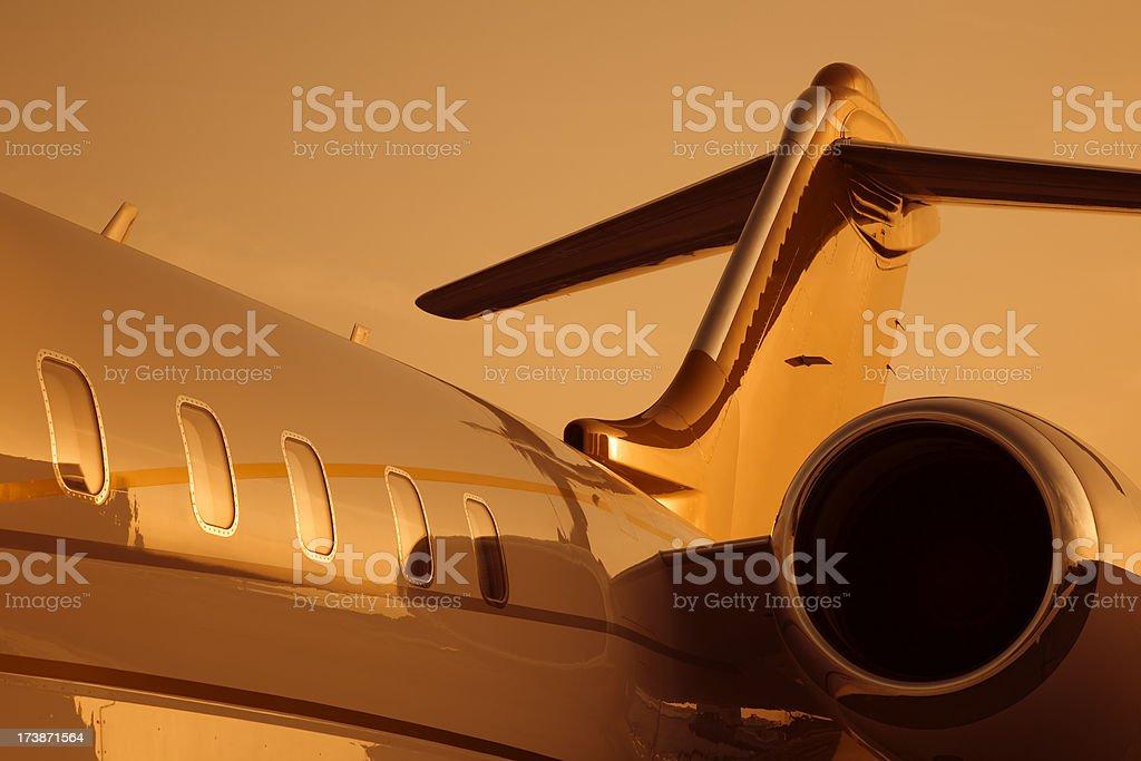 Corporate jet under orange sunset light royalty-free stock photo