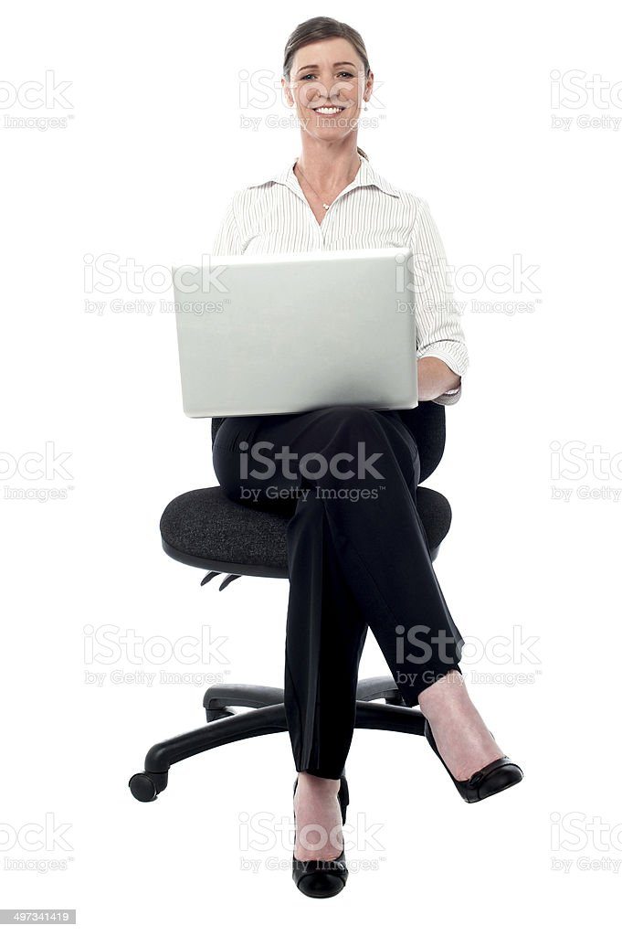 Corporate lady working on her laptop royalty-free stock photo