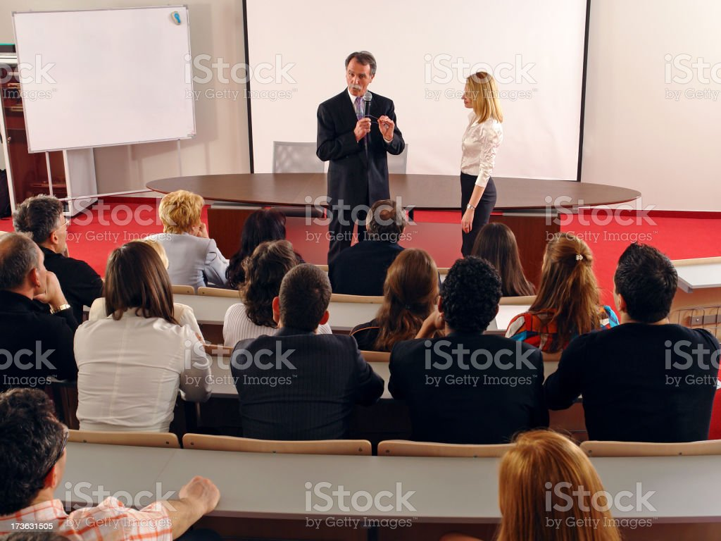 Corporate lecture by business couple in auditorium royalty-free stock photo