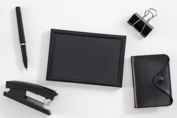 corporate lifestyle office worker supplies set Corporate lifestyle. Office worker supplies set. Flat lay of blank photo frame, business card holder, stationery. Mockup. stapler stock pictures, royalty-free photos & images