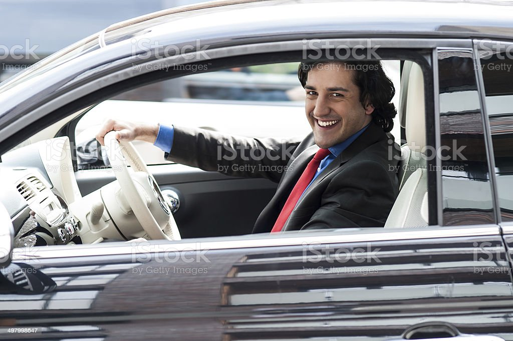 Corporate man driving his car royalty-free stock photo