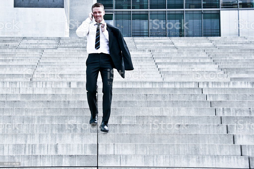 Corporate Man With Cellular Phone On Stairs stock photo