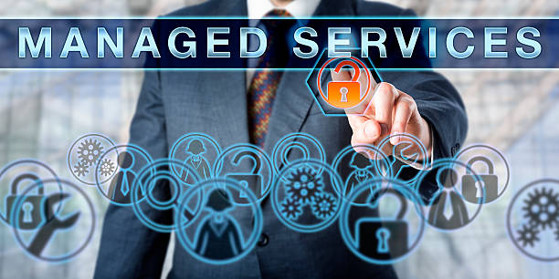 Corporate Manager Pushing MANAGED SERVICES stock photo