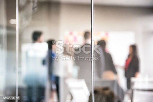 istock Corporate Meeting Behind Glass Wall Blurred Abstract 639279156