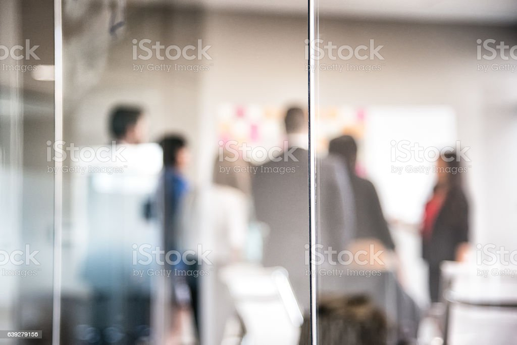 Corporate Meeting Behind Glass Wall Blurred Abstract stock photo