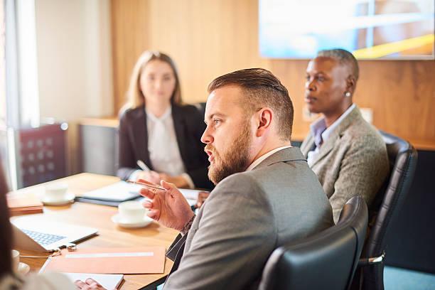 corporate meeting discussions - four lawyers stockfoto's en -beelden