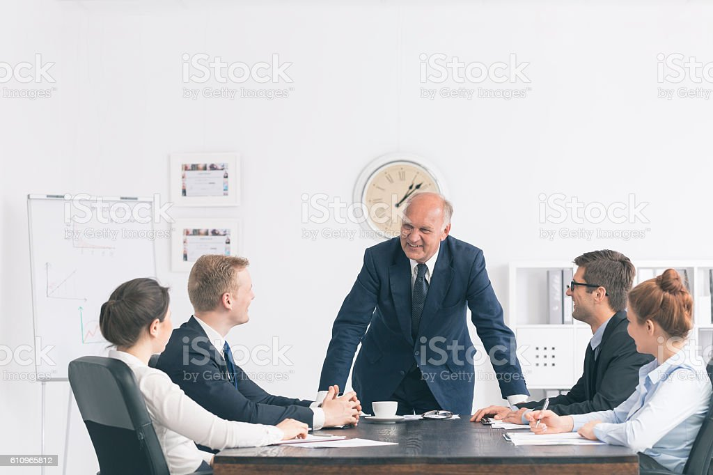 Corporate meeting with a relaxed boss stock photo