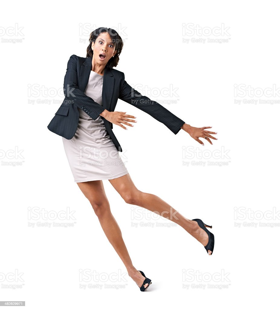 Corporate mishaps - Losing her footing in the corporate world stock photo