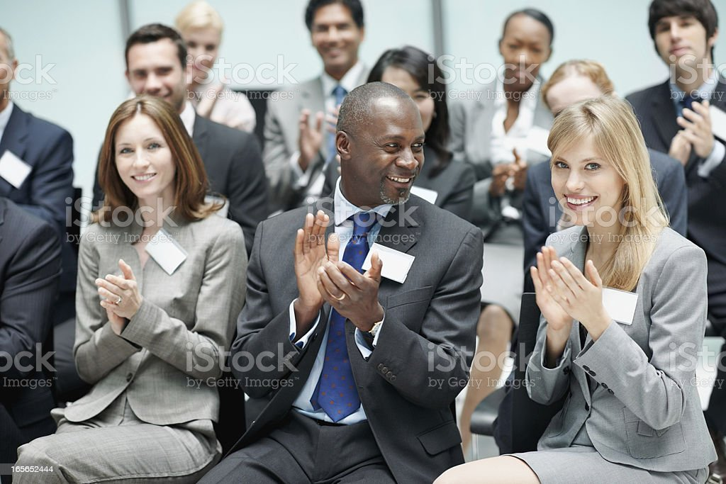Corporate people applauding during seminar royalty-free stock photo